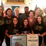 Governor Raimondo takes a photo with studens from Johnson  & Wales University